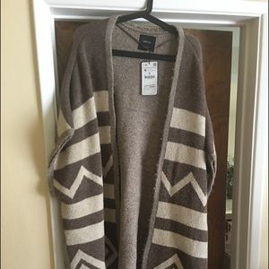 Poncho with tags attached